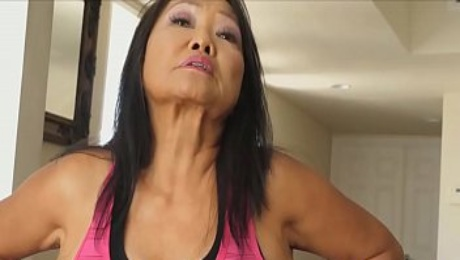 thai grandma plays with a sex machine